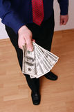Money. Manager holding dollars notes royalty free stock images
