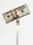 Money. Dollar note on the fork stock image