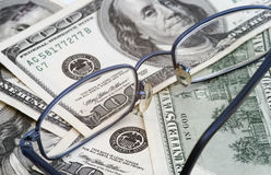 Money. And glasses royalty free stock photos