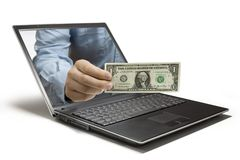 Money. A Hand reaches out of a computer Royalty Free Stock Image