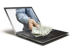 Money. A Hand reaches out of a computer Royalty Free Stock Photo