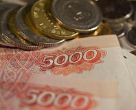 Money. Various coins and rubles notes Stock Photo