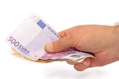 Money. Right hand of a man with some European money Stock Photography