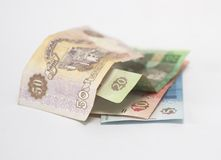 Money. Ukrainian currency of different face-value against white background stock photos