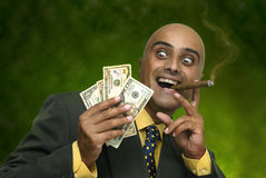 Money. Businessman with money isolated against a dark green  background