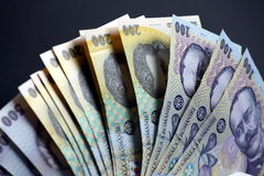 Money. Romania money bills with black background stock images