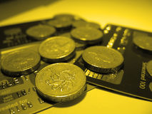Money. English pound counds resting on credit cards stock image