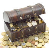 Money. Wooden chest with coins inside isolated background Stock Photos