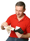 Money. Young the man takes out money from a purse Stock Photo