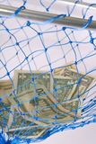 Money. Concept of saving for a rainy day, net savings or catching money royalty free stock photos