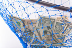 Money. Concept of catching money, saving for a rainy day or net savings royalty free stock image