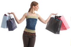 Money. A girl with shopping bags Royalty Free Stock Photo