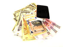 Money. Isolated  luxurious black crocodile purse with loads of euro, dollar and rand notes Royalty Free Stock Images