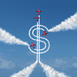Money Achievement. Concept as a group of acrobatic jets in an air show airplanes flying in the sky creating a smoke trail shaped as a dollar sign as a metaphor Stock Photos