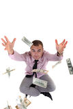 Money in the air. Young man catching money in the air Royalty Free Stock Image