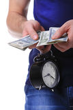 Money and alarm clock in man's hands Stock Photos
