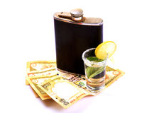 Money and alcohol Stock Image