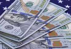 Money on American flag Stock Images