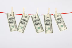 Money american hundred dollar bills hanging on laundry line Royalty Free Stock Image