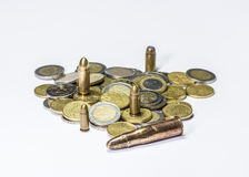 Money and ammunition Royalty Free Stock Photography