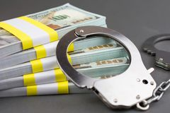 Free Money And Handcuffs. Financial Crime Stock Photography - 148410062
