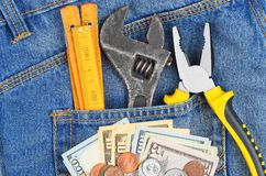Money And Tool In Jeans Pocket Royalty Free Stock Photography