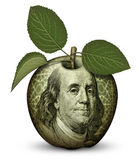 Money Apple. Photo Illustration using parts of U.S. currency bills restructured as an apple Royalty Free Stock Images