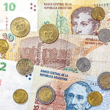 Money from Argentina, peso banknotes and coins. Royalty Free Stock Photos