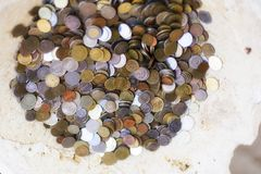Money around the world, in the old bowl royalty free stock photography