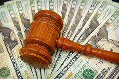 Money array. Court gavel on an array on money Royalty Free Stock Photos