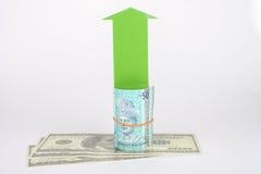 Money with arrow Stock Photo