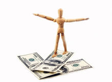 Money arrow and wooden man. That go on them Stock Photo