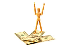 Money arrow and wooden man that go on them Royalty Free Stock Photography