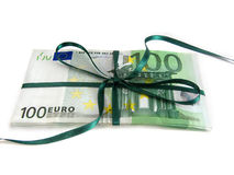 Money as a gift. One hundred euro bills wrapped with a green ribbon royalty free stock images