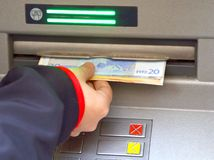 Money from ATM automatic cash machines Stock Photo