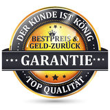 Money back guaranteed - German language. Our client is king. Best price or Money back Guaranteed. Top Quality - business retail golden label in German language Royalty Free Stock Photo