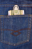 Money in the back pocket of jeans Stock Photos