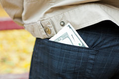 Money in the back pocket of man's trousers Royalty Free Stock Image