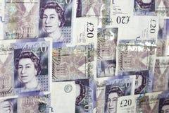 Money background. English twenty pounds notes laid as background Stock Photo