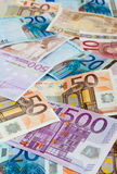 Money Background. Background of euros: ten, twenty, fifty and five-hundred euro banknotes royalty free stock photography