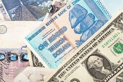 Money background. With US dollars, British pounds, Lithuanian litas and Zimbabwe hundred trillion dollars Royalty Free Stock Photo