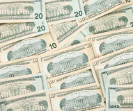 Money background. Of $10 and $20 bills in USA currency facing down Royalty Free Stock Images