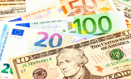 Money background from american dollars and euro Stock Image