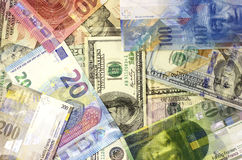 Money background american dollars, euro and swiss franc. Stock Images