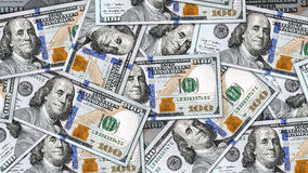 Money Background. Close up money background with lots of new 100 US dollar bills.  Ready to be use as background in 8K, 4K or HD video movie resolution in 16:9 Royalty Free Stock Photos