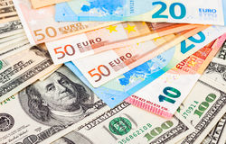 Money background from euro banknotes and dollars Stock Photos