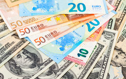 Money background from euro banknotes and dollars Stock Image