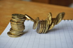 Money background of falling pile of coins as a symbol of financial deterioration Stock Image