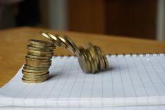Money background of falling pile of coins as a symbol of financial deterioration Royalty Free Stock Photo