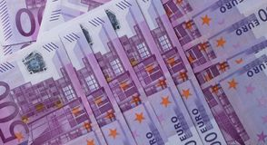 Money background - Five hundred 500 euro bills banknotes. Pile, top view stock images